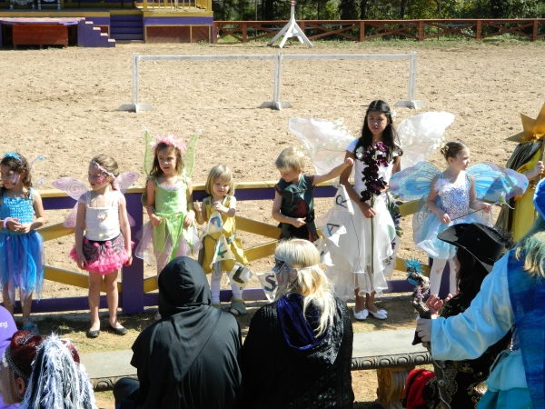 "Kids at the costume contest (the banner was painted by Oona, aged 4, and it reads ""Fulshear Dragon Riders"")"